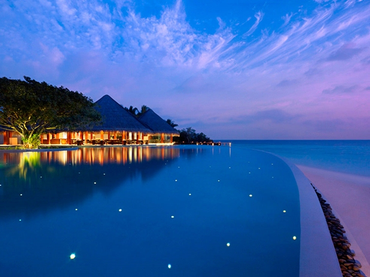 Swimming pool at night in Luxury Dusit Thani Resort in Maldives