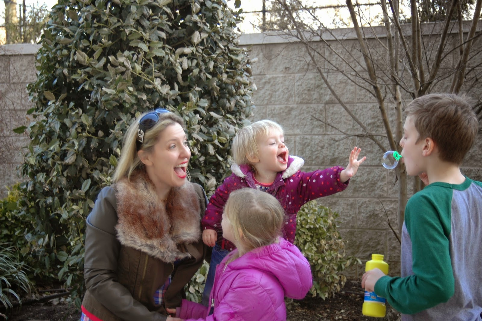 Nicole Kear and her children blowing bubbles