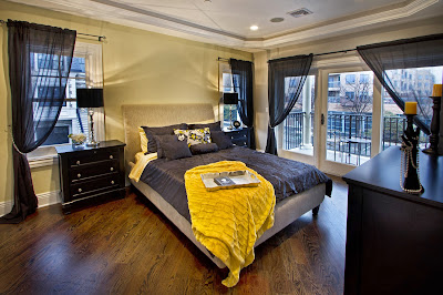 classic bedroom design with beautiful thin curtains revealing windows and balcony with a city view