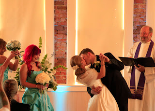 Nicole and Ken kiss at their wedding ceremony in the Hollywood Schoolhouse