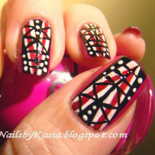 http://prettynailsbykasia.blogspot.com/2014/10/31dc2014-day-16-geometric-nails.html
