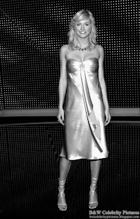 B&W pictures of Lena Gercke beautifully dressed in gold pic 2
