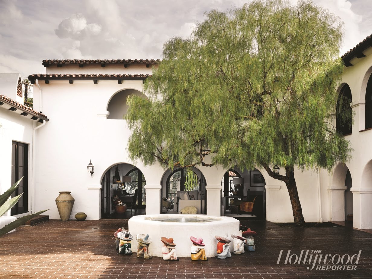 Interior Courtyard Of A Spanish Colonial Revival Home With A Fountain