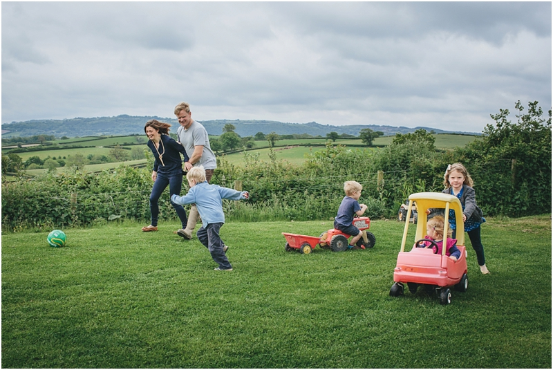 A family playing football at home on their farm