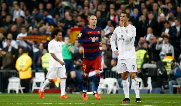 Ouch: Cristiano Ronaldo looks dejected after Andres Iniesta scores Barcelona's third goal