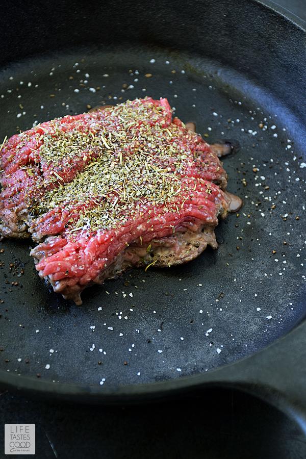 Cheesy Baked Ravioli Skillet | by Life Tastes Good | brown ground beef