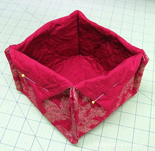 Hand stitch the flaps down on the basket