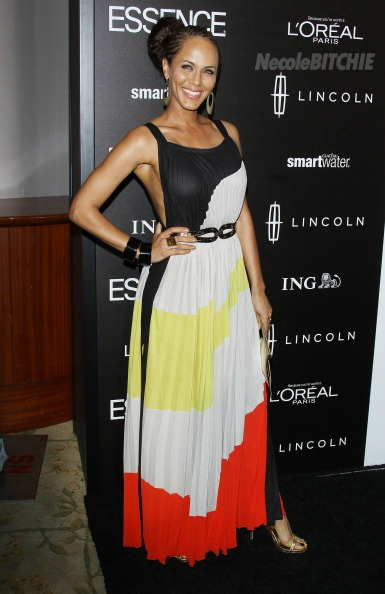 Actress Nicole Ari Parker in a multi-colored-backless maxi dress with gold ...