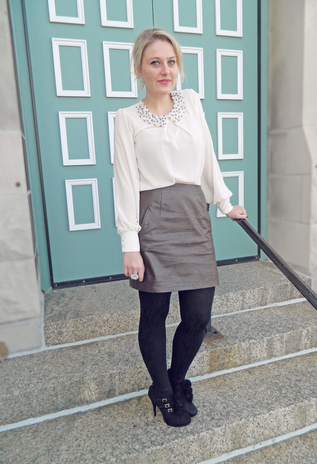 pearled blouse and leather skirt