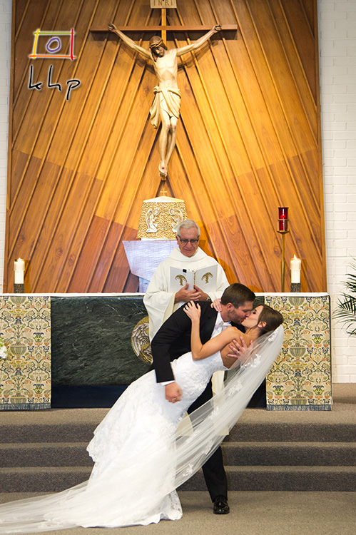 The bride and groom are not joking around for their first kiss as husband and wife