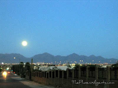full moon rising over mcdowell mountains in scottsdale az