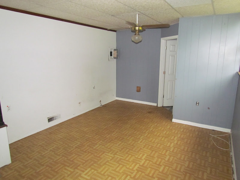 Notice the drop ceiling & the linoleum floor that looks like wood  title=