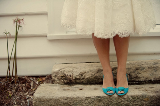 green wedding shoes and lace wedding dress