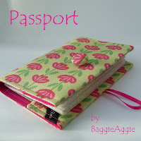 Handmade fabric passport wallet in a contemporary floral fabric in pink and green.