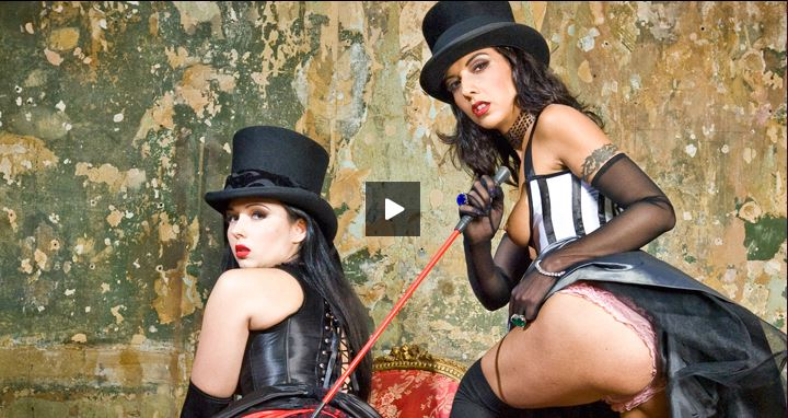 Two horny sluts wearing corsets performing some hot porn in costume