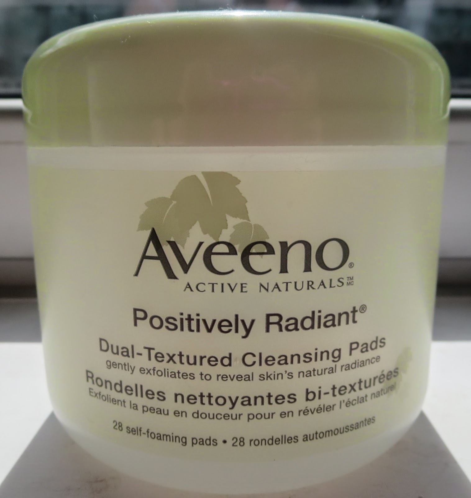 a picture of Aveeno Positively Radiant Dual Textured Cleansing Pads