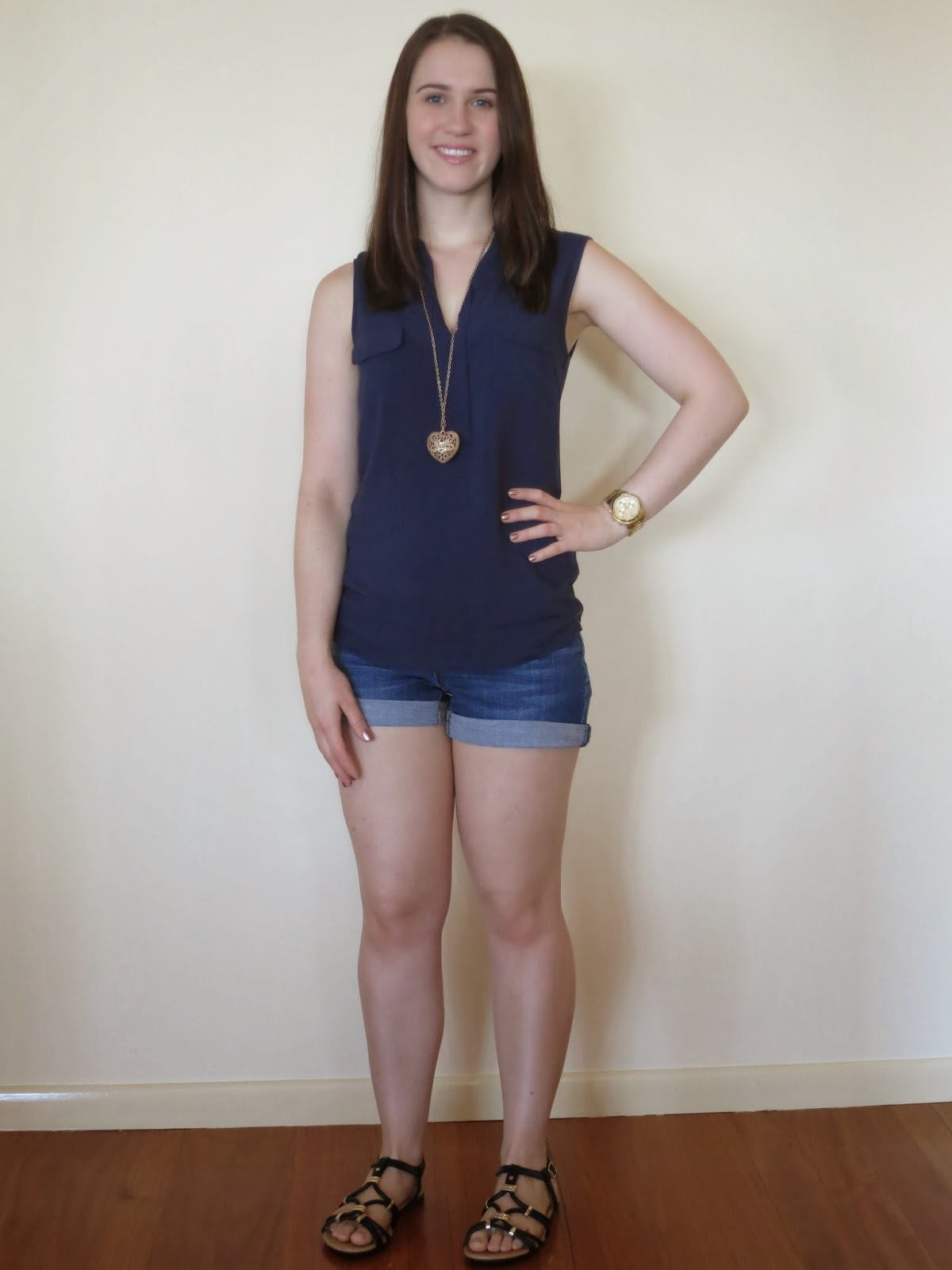 petite outfit, petite everyday outfit, everyday outfit, navy top, dark wash denim shorts, gold jewellery, black sandals and bag with gold hardwar