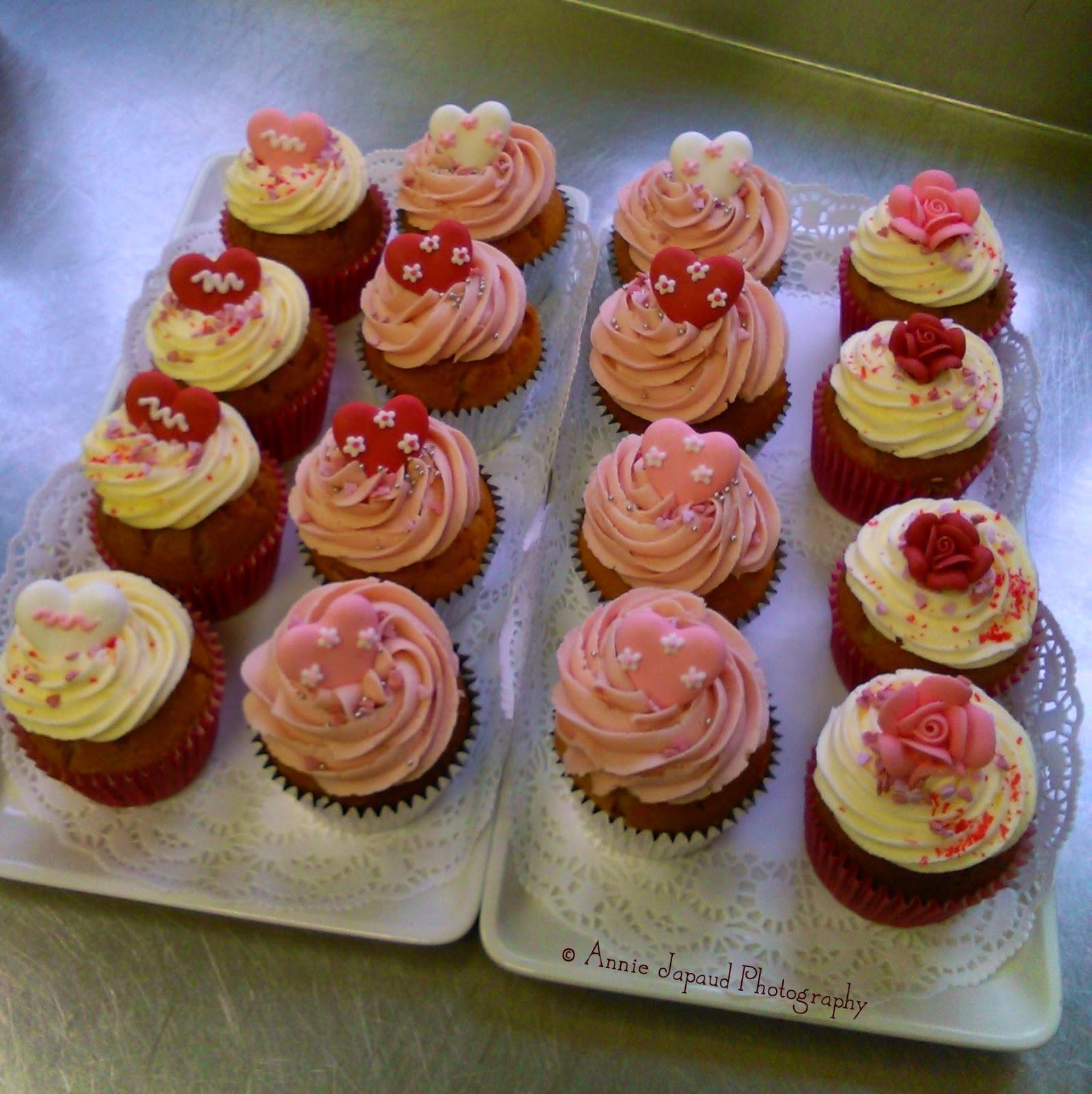 a dozen decorated cupcakes