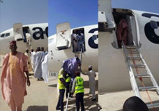 Aero passengers disembarking aircraft with ladder