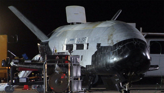 The X-37B appears to be undergoing safing procedures after landing on Dec. 3 at 1:16 a.m. PST (0916 GMT). Significant weathering, or discoloration, can be seen on the spacecraft's upper thermal blanket insulation. (Photo: USAF/Vandenberg)