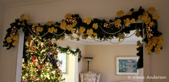 Door trims decorated with Christmas garlands in gold