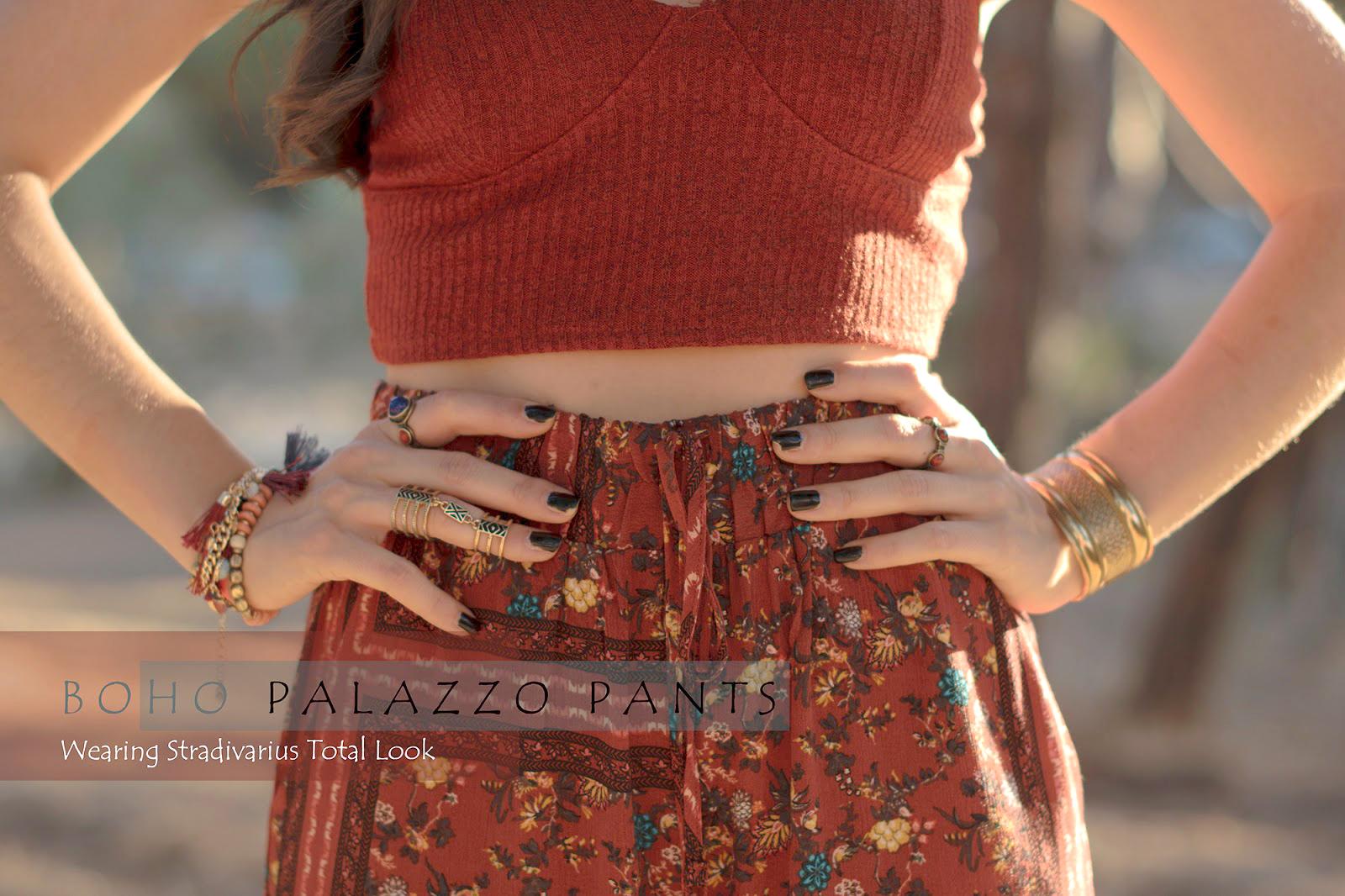 Look boho con pantalones palazzo y top crop de Stradivarius