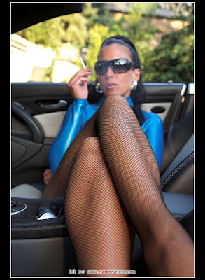 Latex Mistress Smoking in Sports Car