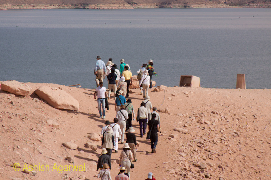 Tourists heading towards a bend while on the way to the Abu Simbel temple in Egypt