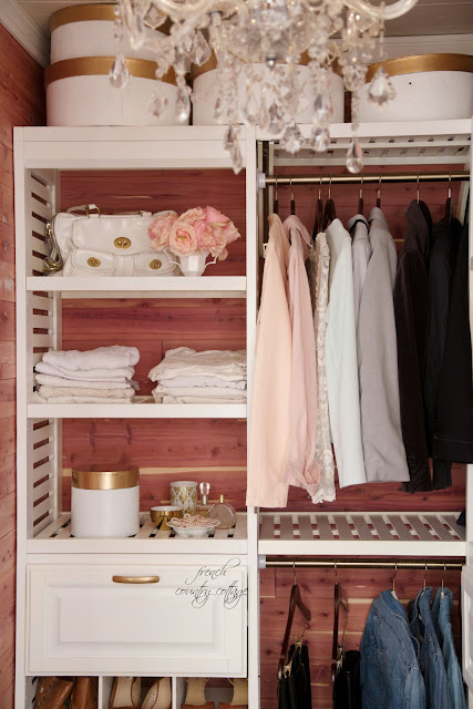 Closet makeover with chandelier and cedar plank walls