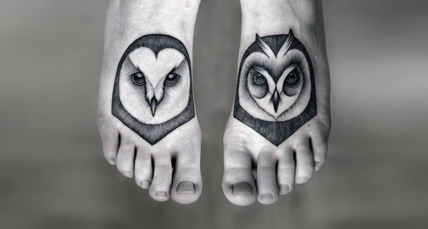 Black grey owls head tattoo on feet by Kamil Czapiga