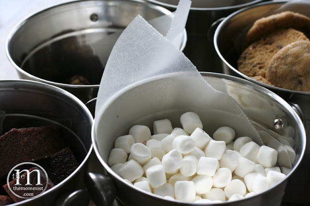 marshmallow, brownies, cookies in a stainless bucket