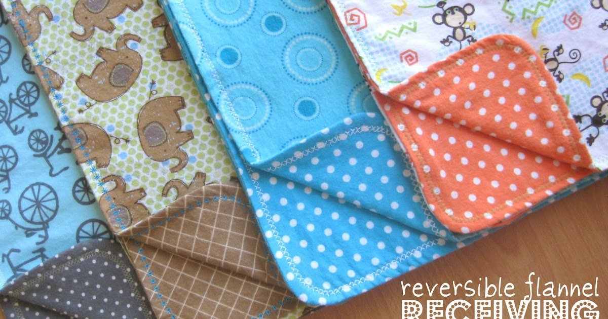 reversible flannel receiving blankets with decorative stitching...