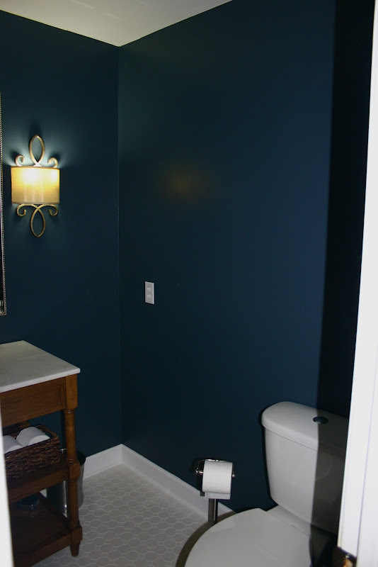 Here was the bathroom when we went under contract. Yes that is half of  title=