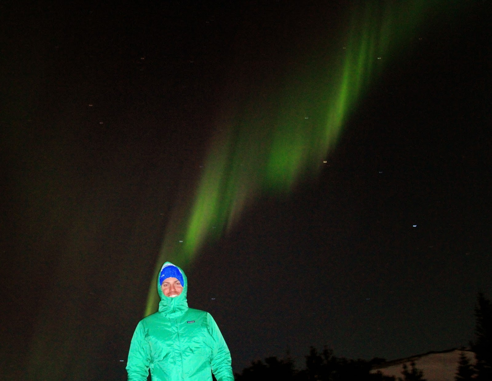 Wrapped up warm watching the Northern Lights - Reykjavik, Iceland