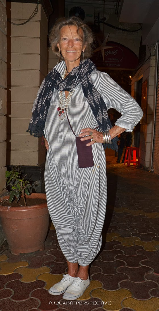 Loulou wears a loose jumpsuit in stripes in an updated boho chic look.