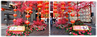 2012 CNY decorations: giant cherry blossom trees and red lanterns at the entrance of Pavilion KL