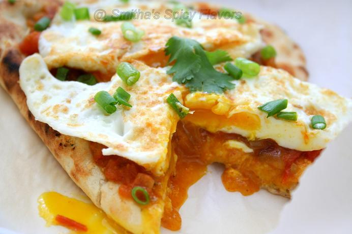 Huevos rancheros with an indian twist smithas spicy flavors huevos rancheros is a mexican dish which is served as breakfast its mostly served on a warm tortilla which is like a roti topped with sauteed onions and forumfinder Gallery