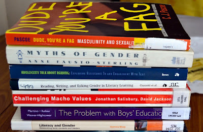 Pile of books on gender and reading