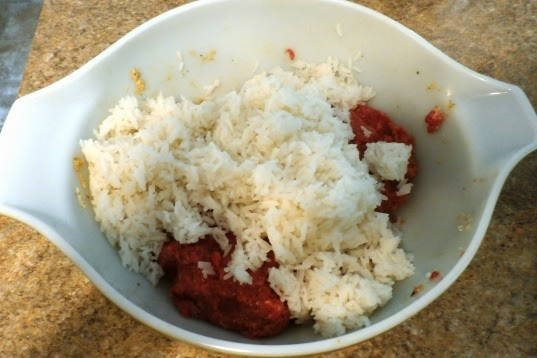 Mixing the ground meat and rice