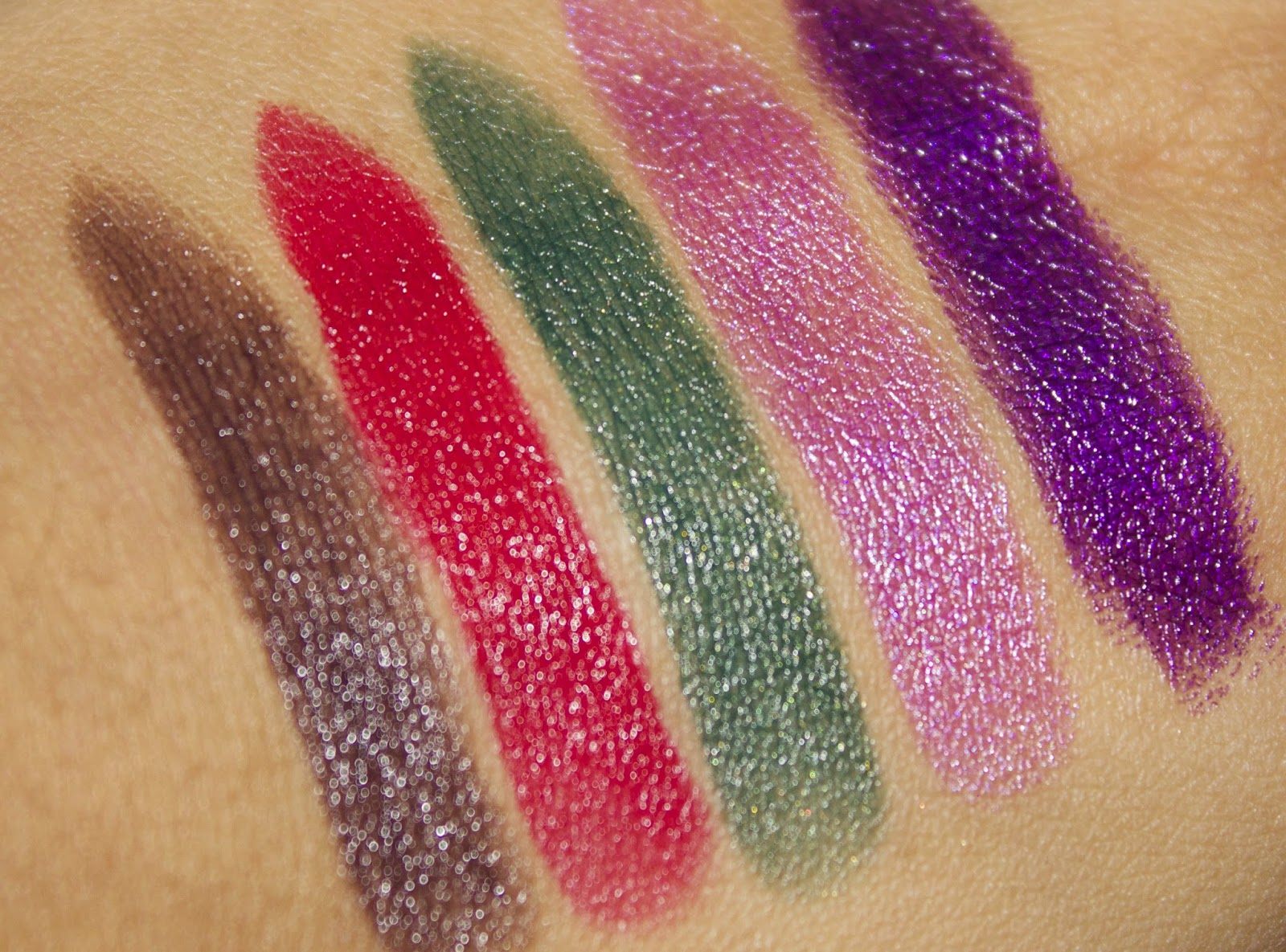 A picture of hand swatches of the Makeup Revolution Atomic lipsticks