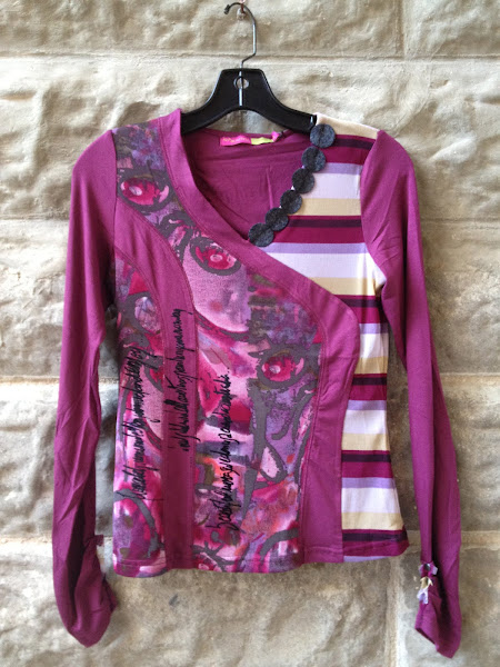 French multi printed long sleeve top with writing and felted circles.