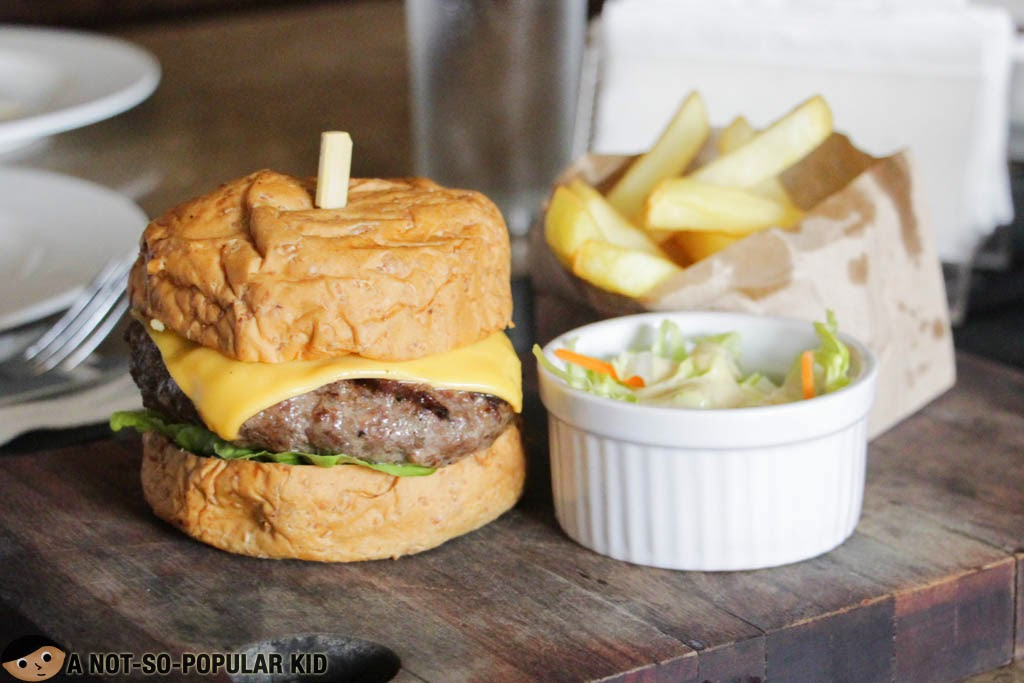 Dillinger's 1903 Cheeseburger served with fries and coleslaw