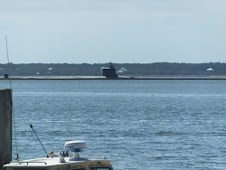 A sub heads in to port