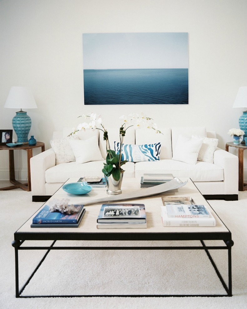 coastal modern living room with white sofa and blue and white pillows