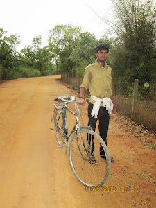 "Forest Employee Mr Sushil.Singh on his cycle on the road near the ""TIGER KILL""."