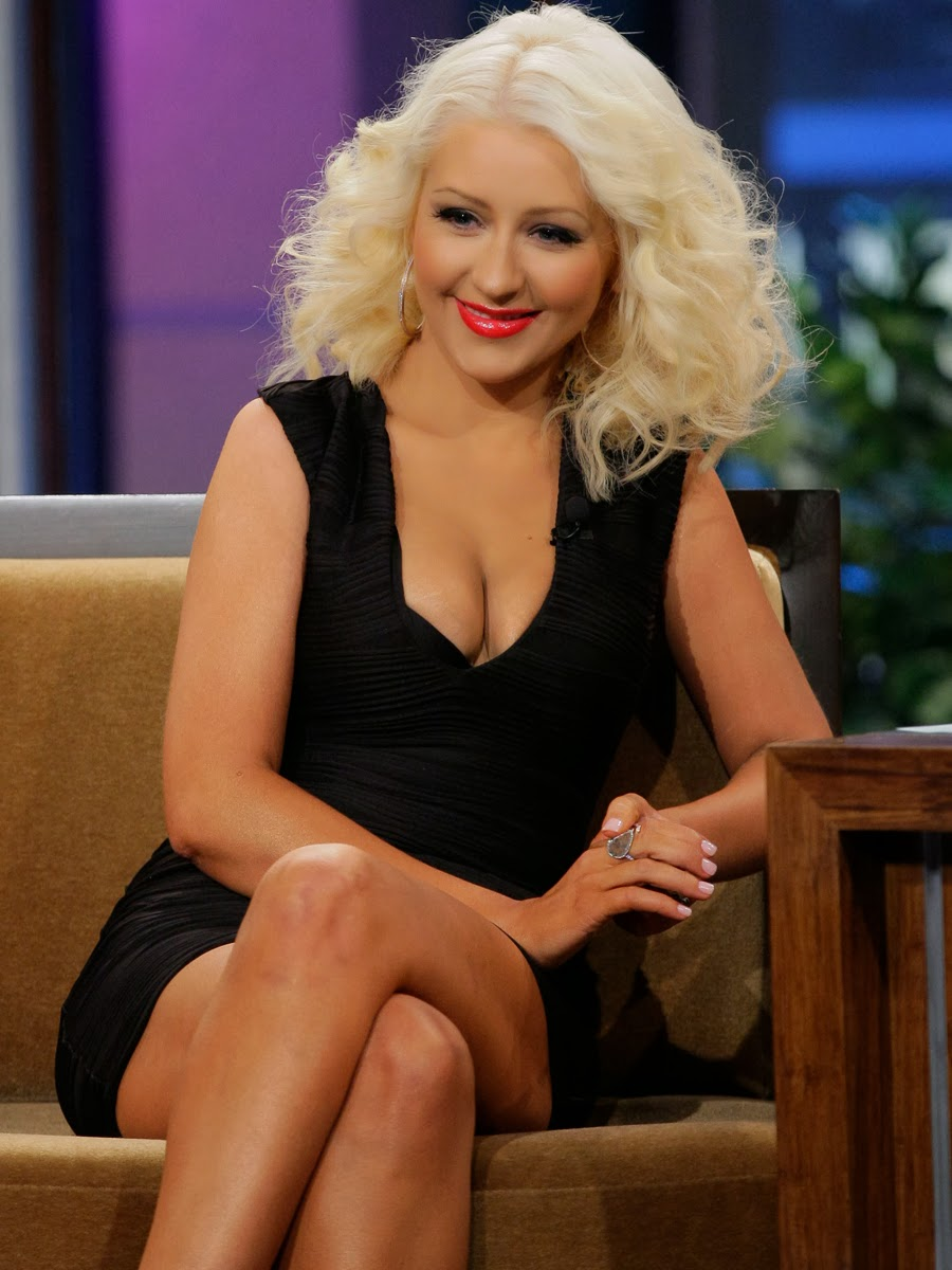 Christina Aguilera with cleavy tight dress