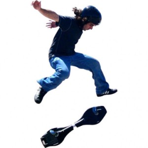 Teen jumping with a ripstik against white background
