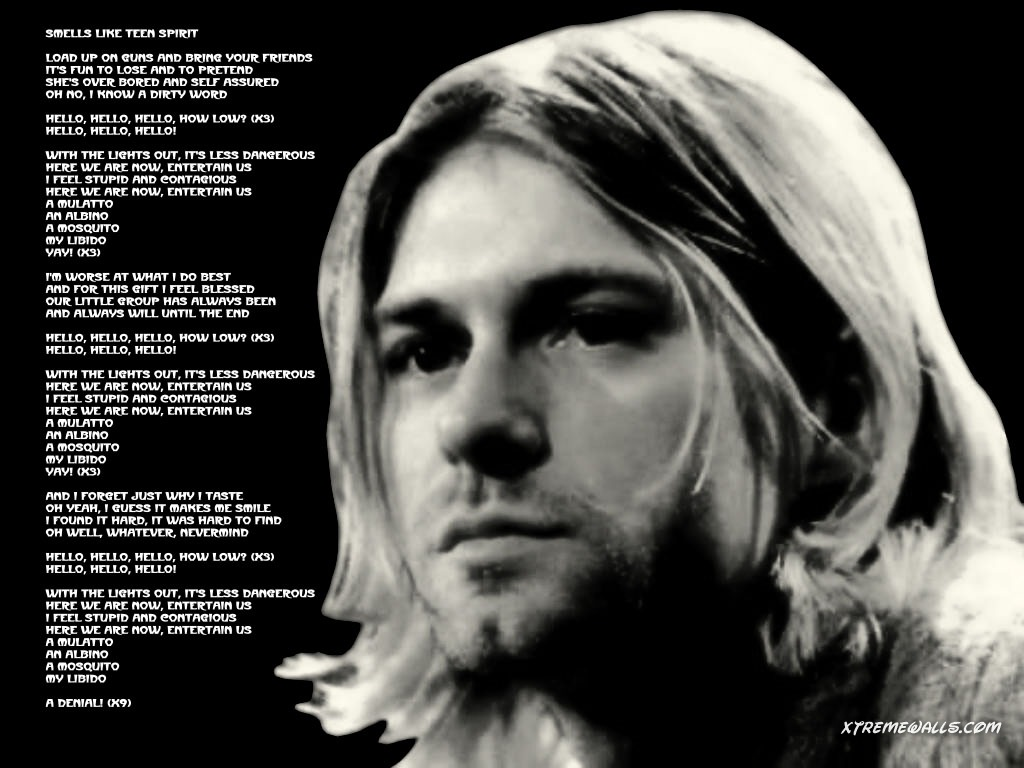 http://4.bp.blogspot.com/-0Hq2t6YFXFA/URlsAzR9IsI/AAAAAAAAO6E/HuT1gEmEmZI/s1600/nirvana_kurt_cobain_wallpaper_smell+like+teen+spirit+lyrics.jpg
