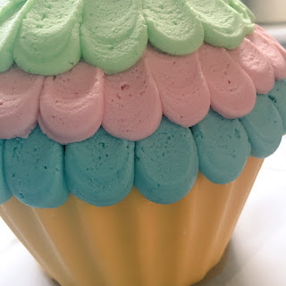 Giant Cupcake Cake with Rainbow Frosting