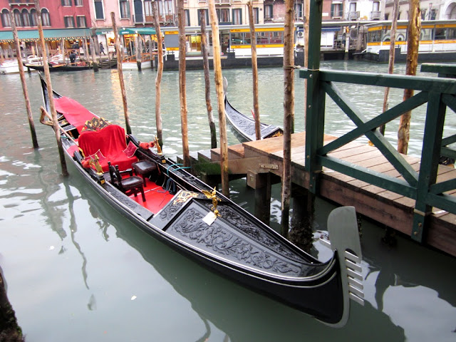 The gondola benchwarmers and a beautiful boat